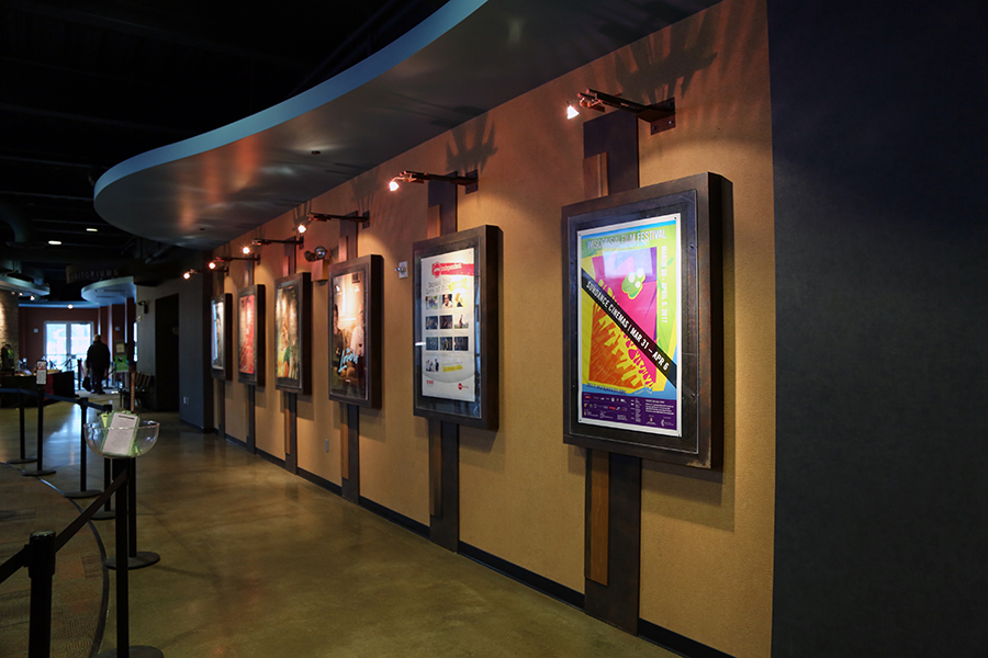 Hallway at AMC Madison 6 showcasing marquee posters